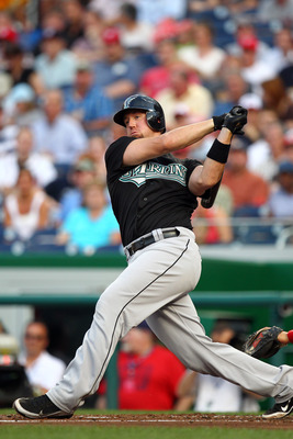 WASHINGTON, DC - JULY 27: John Buck #14 of the Florida Marlins hits the ball against the Washington Nationals at Nationals Park on July 27, 2011 in Washington, DC. The Marlins won 7-5. (Photo by Ned Dishman/Getty Images)