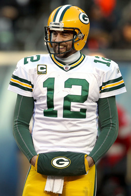 CHICAGO, IL - JANUARY 23:  Quarterback Aaron Rodgers #12 of the Green Bay Packers smiles in the second half against the Chicago Bears in the NFC Championship Game at Soldier Field on January 23, 2011 in Chicago, Illinois.  (Photo by Jonathan Daniel/Getty