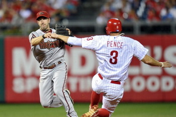 PHILADELPHIA, PA - AUGUST 16: Willie Bloomquist #18 of the Arizona Diamondbacks puts out Hunter Pence #3 of the Philadelphia Phillies at second base on a double play in the eighth inning at Citizens Bank Park on August 16, 2011 in Philadelphia, Pennsylvan