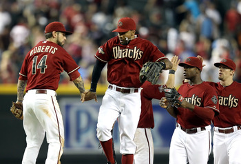 PHOENIX, AZ - AUGUST 14:  Chris Young #24 and Ryan Roberts #14 of the Arizona Diamondbacks high five after defeating the New York Mets in the Major League Baseball game at Chase Field on August 14, 2011 in Phoenix, Arizona. The Diamondbacks defeated the M