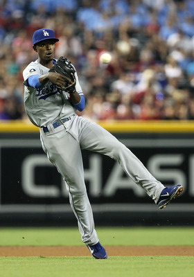 PHOENIX, AZ - AUGUST 06:  Infielder Dee Gordon #9 of the Los Angeles Dodgers fields a ground ball out against the Arizona Diamondbacks during the Major League Baseball game at Chase Field on August 6, 2011 in Phoenix, Arizona.  The Dodgers defeated the Di