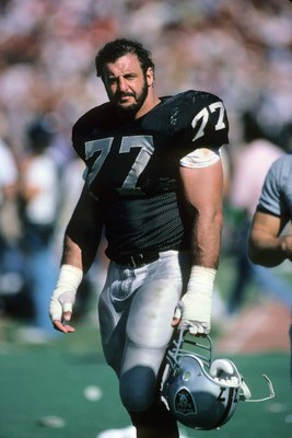 LOS ANGELES, CA - SEPTEMBER 22:  Lyle Alzado #77 of the Los Angeles Raiders stands on the field during the game against the San Francisco 49ers at the Los Angeles Memorial Coliseum on September 22, 1985 in Los Angeles, California.  The 49ers won 34-10. (P
