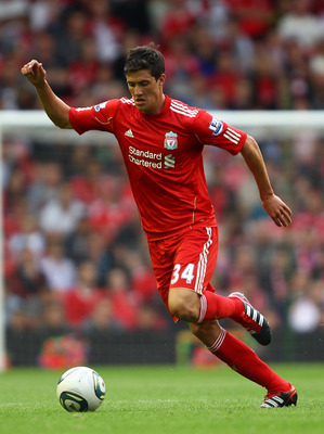 LIVERPOOL, ENGLAND - AUGUST 06:  Martin Kelly of Liverpool in action during the pre season friendly match between Liverpool and Valencia at Anfield on August 6, 2011 in Liverpool, England.  (Photo by Clive Brunskill/Getty Images)