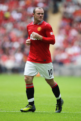 LONDON, ENGLAND - AUGUST 07:  Wayne Rooney of Manchester United in action during the FA Community Shield match sponsored by McDonald's between Manchester City and Manchester United at Wembley Stadium on August 7, 2011 in London, England.  (Photo by Clive