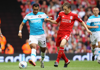 LIVERPOOL, ENGLAND - AUGUST 13:  Ahmed Elmohamady of Sunderland and Leiva Lucas of Liverpool battle for the ball during the Barclays Premier League match between Liverpool and Sunderland at Anfield on August 13, 2011 in Liverpool, England.  (Photo by Cliv