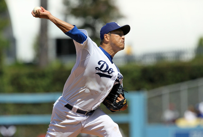 LOS ANGELES, CA - AUGUST 14:  Hiroki Kuroda #18 of the Los Angeles Dodgers throws a pitch against the Houston Astros on August 14, 2011 at Dodger Stadium in Los Angeles, California. The Dodgers won 7-0.  (Photo by Stephen Dunn/Getty Images)