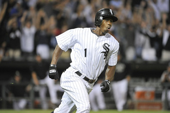 CHICAGO, IL - AUGUST 17:  Juan Pierre #1 of the Chicago White Sox runs up the first base line after hitting a game-winning RBI double scoring Gordon Beckham during the 14th inning against the Clevland Indians at U.S. Cellular Field on August 17, 2011 in C