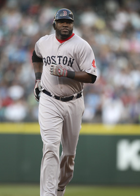 SEATTLE - AUGUST 12:  David Ortiz #34 of the Boston Red Sox rounds the bases on a solo homer in the second inning against the Seattle Mariners at Safeco Field on August 12, 2011 in Seattle, Washington. (Photo by Otto Greule Jr/Getty Images)