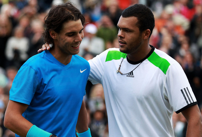 LONDON, ENGLAND - JUNE 10:  Jo-Wilfred Tsonga of France and Rafael Nadal of Spain shake hands at the net after their his Men's Singles quarter final match on day five of the AEGON Championships at Queens Club on June 10, 2011 in London, England.  (Photo b