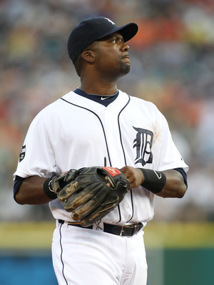 DETROIT, MI - AUGUST 03: Wilson Betemit #20 checks the scoreboard during the game against the Texas Rangers at Comerica Park on August 3, 2011 in Detroit, Michigan. The Tigers defeated the Rangers 5-4. (Photo by Leon Halip/Getty Images)
