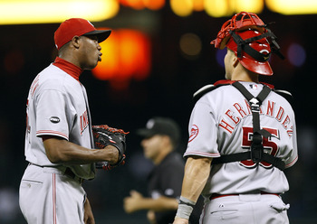 HOUSTON - AUGUST 02:  Pitcher Aroldis Chapman #54 of the Cincinnati Reds talks to catcher Ramon Hernandez #55 after the final out at Minute Maid Park on August 2, 2011 in Houston, Texas.  Cincinnati won 5-1. (Photo by Bob Levey/Getty Images)