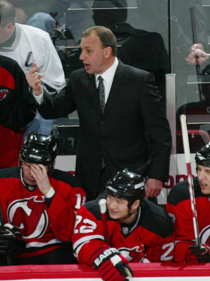NEWARK, NJ - FEBRUARY 08: Head coach Brent Sutter of the New Jersey Devils gives his players instructions during the game against the Anaheim Ducks on February 8, 2008 at the Prudential Center in Newark, New Jersey.  (Photo by Bruce Bennett/Getty Images)