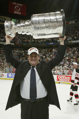 EAST RUTHERFORD, NJ - JUNE 9:  Head coach Pat Burns of the New Jersey Devils holds up the Stanley Cup after defeating the Mighty Ducks of Anaheim 3-0 in game seven of the 2003 Stanley Cup Finals at Continental Airlines Arena on June 9, 2003 in East Ruther