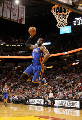 MIAMI, FL - FEBRUARY 27:  Amar'e Stoudemire #1 of the New York Knicks dunks during a game against the Miami Heat at American Airlines Arena on February 27, 2011 in Miami, Florida. NOTE TO USER: User expressly acknowledges and agrees that, by downloading a