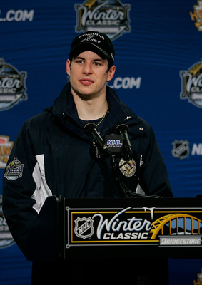 PITTSBURGH, PA - JANUARY 01: Sidney Crosby #87 of the Pittsburgh Penguins talks to the media during a press conference after losing 3-1 to the Washington Capitals during the 2011 NHL Bridgestone Winter Classic at Heinz Field on January 1, 2011 in Pittsbur
