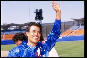28 Jul 1991: Pitcher Dennis Martinez of the Montreal Expos celebrates pitching a perfect game against the Los Angeles Dodgers.