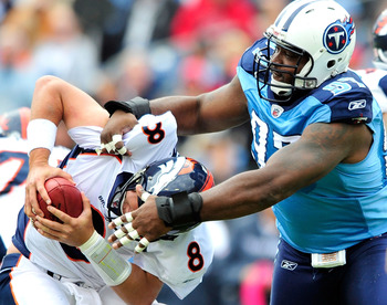 NASHVILLE, TN - OCTOBER 03:  Tony Brown #97 of the Tennessee Titans sacks quarterback Kyle Orton #8 of the Denver Broncos during the first half at LP Field on October 3, 2010 in Nashville, Tennessee.  (Photo by Grant Halverson/Getty Images)