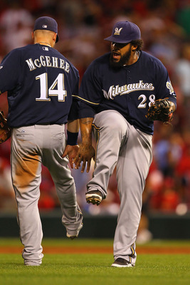 ST. LOUIS, MO - AUGUST 9: Prince Fielder #28 and Casey McGehee #14 both of the Milwaukee Brewers celebrate a victory against the St. Louis Cardinals at Busch Stadium on August 9, 2011 in St. Louis, Missouri.  The Brewers beat the Cardinals 5-3 in 10 innin