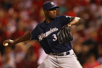 ST. LOUIS, MO - AUGUST 9: LaTroy Hawkins #32 of the Milwaukee Brewers pitches against the St. Louis Cardinals at Busch Stadium on August 9, 2011 in St. Louis, Missouri.  The Brewers beat the Cardinals 5-3 in 10 innings.  (Photo by Dilip Vishwanat/Getty Im