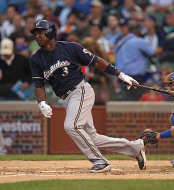 CHICAGO, IL - JUNE 14:  Yuniesky Betancourt #3 of the Milwaukee Brewers takes a swing against the Chicago Cubs at Wrigley Field on June 14, 2011 in Chicago, Illinois. The Cubs defeated the Brewers 5-4 in 10 innings.  (Photo by Jonathan Daniel/Getty Images