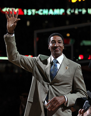 CHICAGO, IL - MARCH 12: Former player Scottie Pippen of the Chicago Bulls waves to the crowd during a 20th anniversary recognition ceremony of the Bulls 1st NBA Championship in 1991 during half-time of a game bewteen the Bulls and the Utah Jazz at the Uni