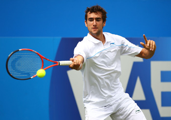 LONDON, ENGLAND - JUNE 08:  Marin Cilic of Croatia returns a shot during his Men's Singles second round match against Arnaud Clement of France on day three of the AEGON Championships at Queens Club on June 8, 2011 in London, England.  (Photo by Clive Brun