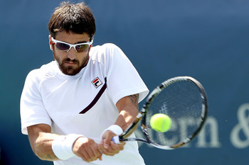 MASON, OH - AUGUST 16:  Janko Tipsarevic of Serbia returns a shot to Edouard Roger-Vasselin of France during the Western &amp; Southern Open at the  Lindner Family Tennis Center on August 16, 2011 in Mason, Ohio.  (Photo by Matthew Stockman/Getty Images)