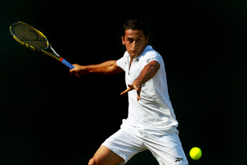 LONDON, ENGLAND - JUNE 25:  Nicolas Almagro of Spainlines up a shot during his third round match against  Mikhail Youzhny of Russia on Day Six of the Wimbledon Lawn Tennis Championships at the All England Lawn Tennis and Croquet Club on June 25, 2011 in L
