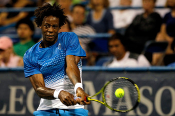 WASHINGTON, DC - AUGUST 06: Gael Monfils of France returns a shot to John Isner during the semifinals of the Legg Mason Tennis Classic presented by Geico at the William H.G. FitzGerald Tennis Center on August 6, 2011 in Washington, DC.  (Photo by Matthew