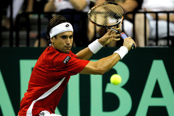 AUSTIN, TX - JULY 08:  David Ferrer of Spain returns a shot to Andy Roddick in their tie during the Davis Cup between USA and Spain at the Frank Erwin Center on July 8, 2011 in Austin, Texas.  (Photo by Matthew Stockman/Getty Images)
