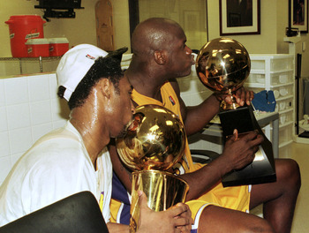 19 Jun 2000:  Shaquille O''Neal and Kobe Bryant of the Los Angeles Lakers kiss the MVP and NBA Championship trophys while in the locker room after defeating the Indiana Pacers in game 6 of the NBA Finals to win the series 4-2 at the Staples Center in Los