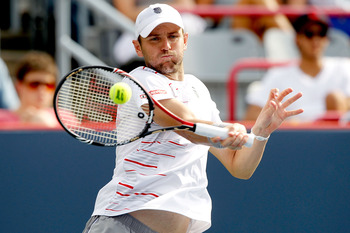 MONTREAL, QC - AUGUST 13:  Mardy Fish of the United States returns a shot to Janko Tipsarevic of Serbia during the Rogers Cup at Uniprix Stadium on August 13, 2011 in Montreal, Canada.  (Photo by Matthew Stockman/Getty Images)