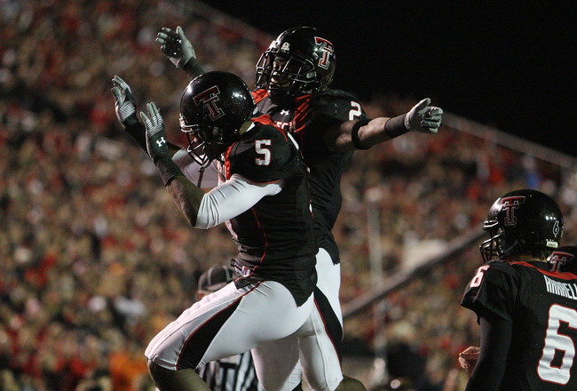 LUBBOCK, TX - NOVEMBER 08:  Wide receiver Michael Crabtree #5 of the Texas Tech Red Raiders celebrates a touchdown with Shannon Woods #2 during play against the Oklahoma State Cowboys at Jones AT&T Stadium on November 8, 2008 in Lubbock, Texas.  (Photo by