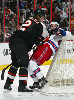 PHILADELPHIA - FEBRUARY 09:  Derian Hatcher #2 of the Philadelphia Flyers hits Ryan Callahan #24 of the New York Rangers into the back of the net on February 9, 2008 at the Wachovia Center in Philadelphia, Pennsylvania.  (Photo by Bruce Bennett/Getty Imag