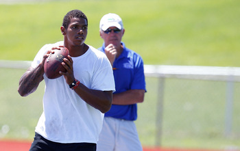 JEANNETTE, PA - AUGUST 12:  Terrelle Pryor works out at a practice facility while quarterbacks coach Ken Anderson looks on on August 12, 2011 in Jeannette, Pennsylvania.  (Photo by Jared Wickerham/Getty Images)