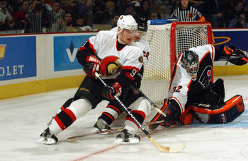 KANATA, CANADA - FEBRUARY 6:  Martin Havlat #9 of the Ottawa Senators attempts a shot on Roman Cechmanek #32 of the Philadelphia Flyers at Corel Centre on February 6, 2003 in Kanata, Ontario. The Flyers and the Senators skated to a 2-2 tie. (Photo By Dave