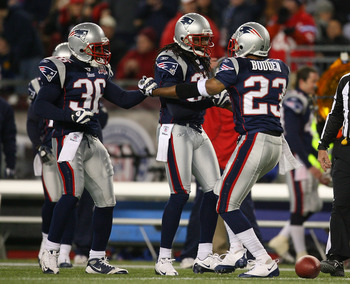 FOXBORO, MA - NOVEMBER 22:  Leigh Bodden #23 of the New England Patriots intercepts a pass and celebrates with teammates James Sanders #36 and Brandon Meriweather #31 against the New York Jets in the fourth quarter during a game against the New York Jets