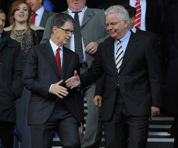 LIVERPOOL, ENGLAND - OCTOBER 17: Everton Chairman Bill Kenwright shakes the hand of new Liverpool owner John W Henry before the Barclays Premier League match between Everton and Liverpool at Goodison Park on October 17, 2010 in Liverpool, England.  (Photo
