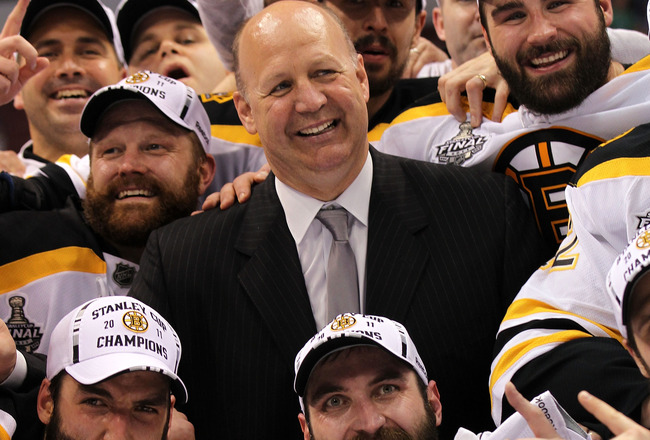 VANCOUVER, BC - JUNE 15:  Head coach Claude Julien, Tim Thomas #30, Patrice Bergeron #37 and Zdeno Chara #33 of the Boston Bruins pose with the Stanley Cup after defeating the Vancouver Canucks in Game Seven of the 2011 NHL Stanley Cup Final at Rogers Are