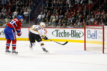 MONTREAL- APRIL 20:  Chuck Kobasew #12 of the Boston Bruins scores an empty net goal during Game Three of the Eastern Conference Quarterfinals of the 2009 Stanley Cup Playoffs against the Montreal Canadiens at the Bell Centre on April 20, 2009 in Montreal