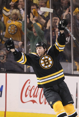 BOSTON - APRIL 19:  Dennis Wideman #6 of the Boston Bruins celebrates his goal in the first period against the Buffalo Sabres in Game Three of the Eastern Conference Quarterfinals during the 2010 NHL Stanley Cup Playoffs at TD Garden on April 19, 2010 in