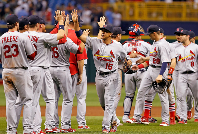 ST. PETERSBURG, FL - JULY 01:  Outfielder John Jay #15 of the St. Louis Cardinals is congratulated by his teammates after their victory over the Tampa Bay Rays at Tropicana Field on July 1, 2011 in St. Petersburg, Florida.  (Photo by J. Meric/Getty Images