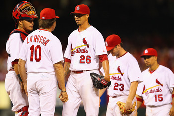 ST. LOUIS, MO - AUGUST 12:  Kyle Lohse #26 of the St. Louis Cardinals is pulled from the game by manager Tony La Russa #10 as teammate Yadier Molina #4 looks on at Busch Stadium on August 12, 2011 in St. Louis, Missouri.  The Cardinals beat the Rockies 6-