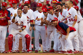 ST. LOUIS, MO - JUNE 4: Members of the St. Louis Cardinals wait for teammate Albert Pujols #5 at home plate after Pujols hit a walk-off home run against the Chicago Cubs at Busch Stadium on June 4, 2011 in St. Louis, Missouri.  The Cardinals beat the Cubs