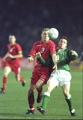 29 Oct 1997:  Ray Houghton (right) of Ireland challenges Mike Verstraeten of Belgium during the World Cup Qualifier play off, first leg match at Lansdowne Road in Dublin, Ireland. The match was drawn 1-1. \ Mandatory Credit: Stu Forster /Allsport