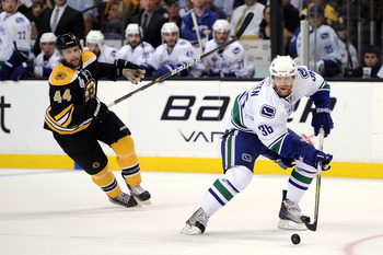 BOSTON, MA - JUNE 08:  Jannik Hansen #36 of the Vancouver Canucks skates against Dennis Seidenberg #44 of the Boston Bruins during Game Four of the 2011 NHL Stanley Cup Final at TD Garden on June 8, 2011 in Boston, Massachusetts.  (Photo by Harry How/Gett