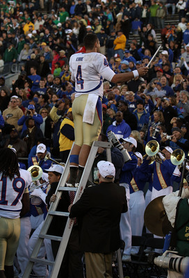 SOUTH BEND, IN - OCTOBER 30: G.J. Kinne #4 of the Tulsa Golden Hurricane conducts the band after a win over the Notre Dame Fighting Irish at Notre Dame Stadium on October 30, 2010 in South Bend, Indiana. Tulsa defeated Notre Dame 28-27. (Photo by Jonathan