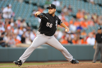 BALTIMORE, MD - AUGUST 11:  Mark Buehrle #56 of the Chicago White Sox pitches during a baseball game against the Baltimore Orioles at Oriole Park at Camden Yards on August 11, 2011 in Baltimore, Maryland.  (Photo by Mitchell Layton/Getty Images)