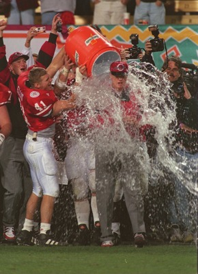 2 JAN 1996:  HEAD COACH TOM OSBORNE OF THE NEBRASKA CORNHUSKERS GETS A CONGRATULATORY BATH FOLLOWING THE FIESTA BOWL AT SUN DEVIL STADIUM IN TEMPE, ARIZONA.   Mandatory Credit: Stephen Dunn/ALLSPORT