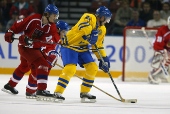 17 Feb 2002:   Niklas Sundstrom #24 of Sweden controls the puck inside the Czech Republic zone with Patrik Elias #25 of the Czech Republic pressuring him during the Salt Lake City Winter Olympic Games at the E Center in Salt Lake City, Utah. DIGITAL IMAGE